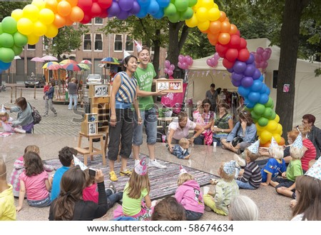 AMSTERDAM, THE NETHERLANDS - AUG 8: Participants of Gay Pride perform at the Pink Kids festival for children of gay, lesbian and bisexual parents, August 8, 2010 in Amsterdam, The Netherlands