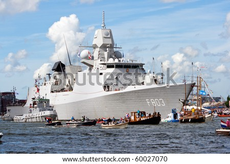 AMSTERDAM, THE NETHERLANDS - AUGUST 19: Dutch Navy frigate HNLMS Tromp arrives at Amsterdam Harbour for SAIL 2010 August 19, 2010 in Amsterdam, The Netherlands