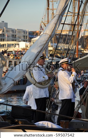 AMSTERDAM,THE NETHERLANDS-AUGUST 20: Music act on a boat at the Sail event 2010 on August 20, 2010 in Amsterdam, The Netherlands.