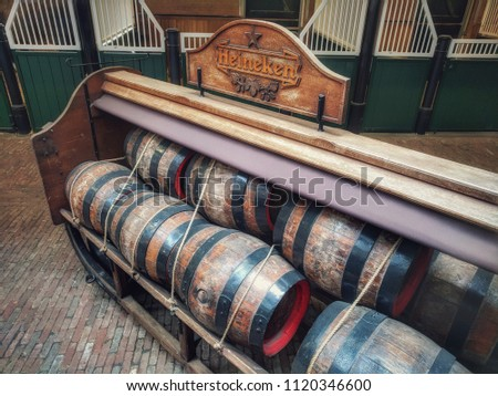 Amsterdam, The Netherlands, June 23  2018: antique beer barrels at Heineken brewery  #1120346600