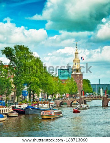 AMSTERDAM THE NETHERLANDS 29 JUNE Canals of Amsterdam on 29 June 2013 Amsterdam is the capital and most populous city of the Netherlands