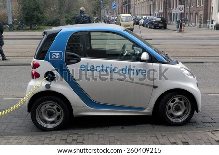 Amsterdam,The Netherlands-march 14,2015: Electric car at a charging station in Amsterdam. Charging it\'s battery