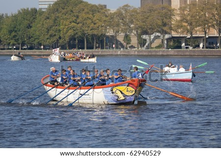 AMSTERDAM, THE NETHERLANDS - OCT 9: Rowing team from the city of Dronten crosses the finish line of the annual 25 km long rowing canal race, October 9, 2010 in Amsterdam, The Netherlands