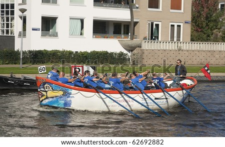 AMSTERDAM, THE NETHERLANDS - OCT 9: Rowing team from the city of Dronten participates in the annual 25 km long canal race, October 9, 2010 in Amsterdam, The Netherlands