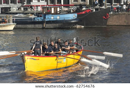 AMSTERDAM, THE NETHERLANDS - OCT 9: Rowing team GRSV from Friesland participates in the annual 25 km long canal race, October 9, 2010 in Amsterdam, The Netherlands