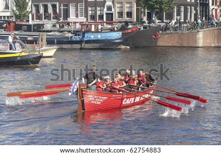 AMSTERDAM, THE NETHERLANDS - OCT 9: Rowing team Stamgasten from the city of Joure participates in the annual 25 km long canal race, October 9, 2010 in Amsterdam, The Netherlands