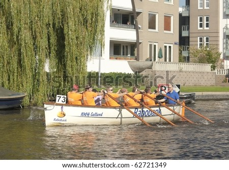 AMSTERDAM, THE NETHERLANDS - OCT 9:  Rowing team Zwarte Water participates in the annual 25 km long canal race, October 9, 2010 in Amsterdam, The Netherlands