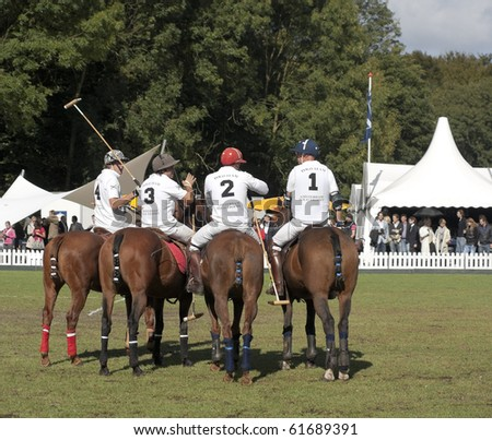 AMSTERDAM, THE NETHERLANDS - SEP 25: Professional international polo players participate in the annual Amsterdam Polo Trophy, September 25, 2010 in Amsterdam, The Netherlands - stock photo