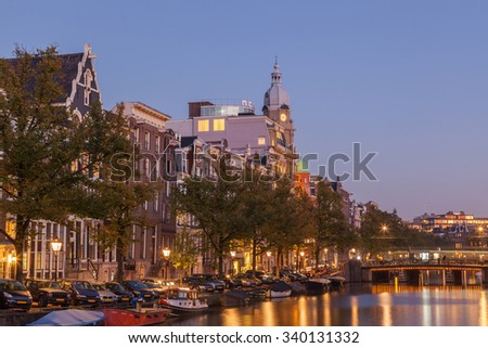 Amsterdams city with canal at dusk twilight #340131332