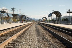 Amtrak station with train tracks leading into distance