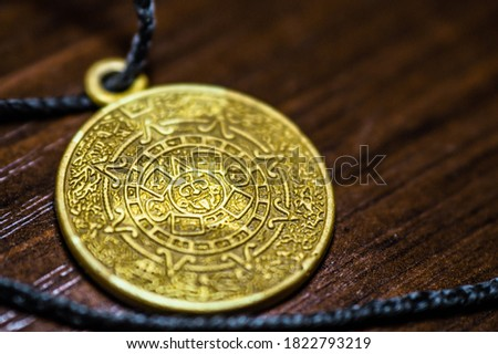 Amulet that attracts good luck. Amulet for a person. Talisman stone of the sun, Calendar of the Aztecs