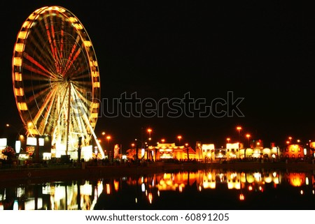 Amusement park at night. conceptual image of entertainment & fun
