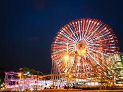 Amusement park at night - Ferris wheel and roller coaster