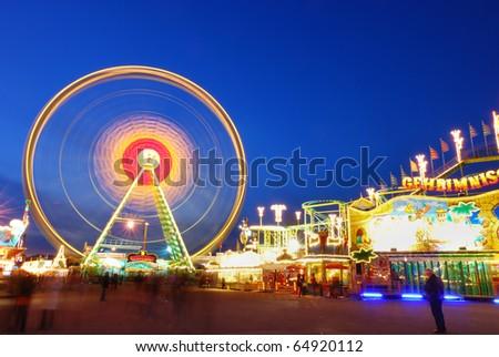 Amusement Park, Ferris Wheel, colorful composition, blue sky at dawn, Fruhlingsfest, Oktoberfest - stock photo