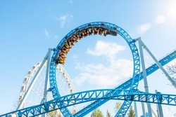 Amusement trolley makes circle loop turns upside down, roller coaster
