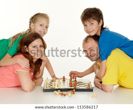 Amusing family of four in bright T-shirt on a white background