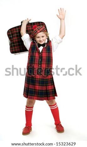 Amusing scotsman boy shot at white background