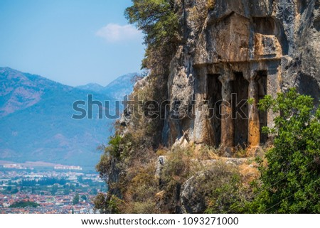 Amyntas rock tombs - 4th BC tombs carved in steep cliff. City of Fethiye, Turkey.