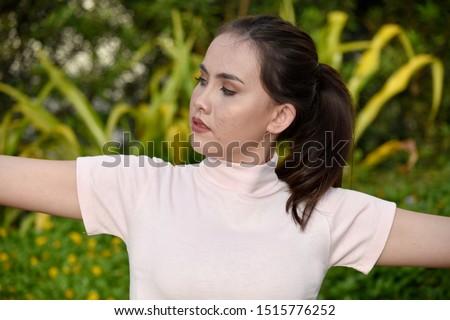 An A Stretching Filipina Female