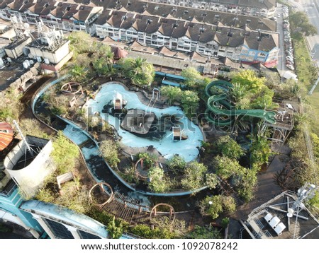An abandon water park on top of a shopping complex in Malaysia. Photo taken on April 2018. #1092078242