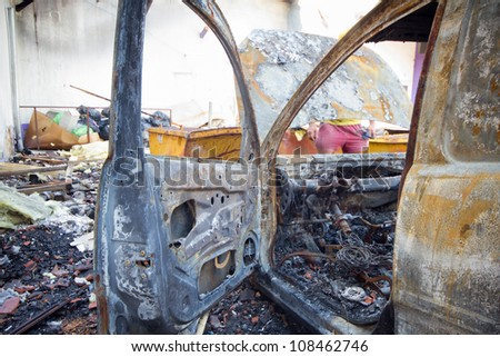 An abandoned burnt down car