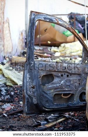 An abandoned burnt down car