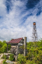 An abandoned cabin and fire tower atop a mountain in southwest Virginia.