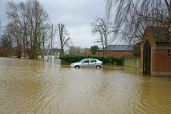 An abandoned car in Swilgate Lane engulfed by the flood water caused by storms Ciara and Dennis, Tewkesbury, Gloucestershire, UK