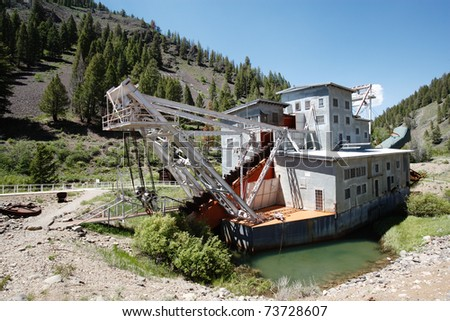 An abandoned decaying gold dredge located on the Yankee Fork of the Salmon river in Custer Idaho, USA