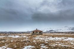 An abandoned farmhouse in a lava field near Borgarnes, Iceland