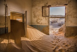 an abandoned house in which for years the wind blew yellow sand from the desert.
