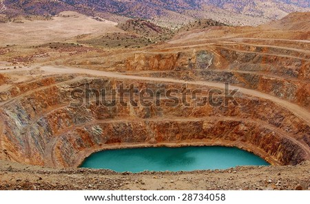 An abandoned open-pit mine in the Mojave Desert - stock photo