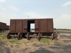 An abandoned railway wagon in a yard