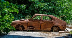 An abandoned rusted car in Elefsina, Greece.
