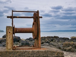 An abandoned, rusting boat winch on the Northern Ireland Antrim coast near Portstewart.
