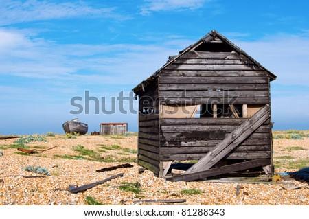 an abandoned shack on a shingle beach