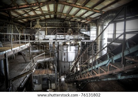 An abandoned sugar factory at it's best, rusted steel, dusty stairs and gigantic halls complete this great scenery.