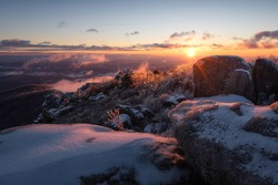 An absolute frigid and windy sunrise atop Old Rag Mountain looking across the icy rock scramble in Shenandoah National Park, Virginia.
