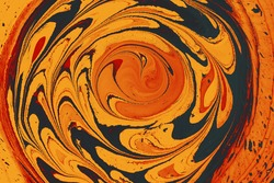 An Abstact texture of twirling paint orange, yellow, and black colors - cool for wallpaper or background