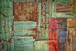 An abstract background image of the flag of Zambia painted on to rusty corrugated iron sheets overlapping to form a wall or fence.