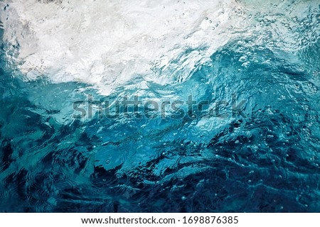 Photo of  An abstract background of seawater flow under light exposure