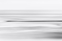An abstract, black &and white seascape of the Pacific ocean off the coast of California.  A long exposure created a pleasing blurred effect.