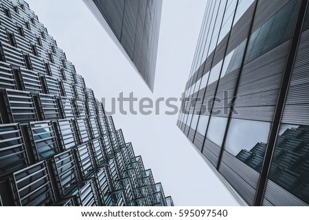 An abstract coloured vintage image, looking up capturing three different buildings on a 45 degree angle #595097540