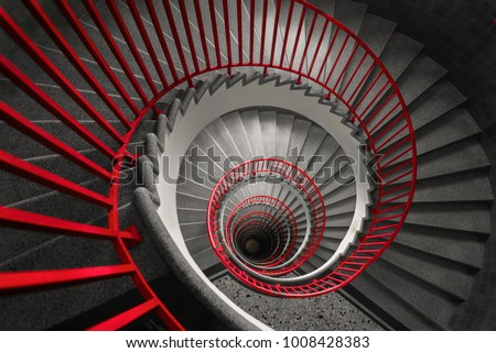 an abstract detail of a spiral staircase in an old building, abstract red and black wallpaper