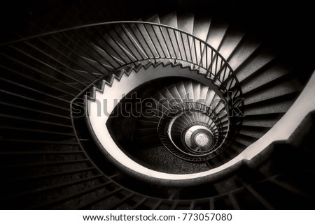 an abstract detail of a spiral staircase in an old building, black and white, monochromatic
