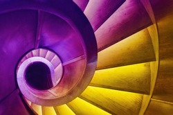 an abstract detail of a spiral staircase in an old building, vibrant colors, fantasy wallpaper