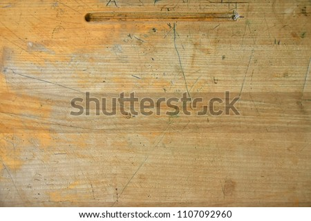 An abstract image of an old wooden desk top.  #1107092960