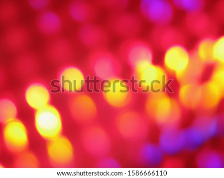 An abstract image of purple, pink and yellow lights