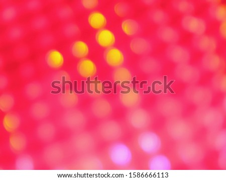 An abstract image of yellow, lilac and pink lights