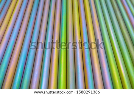An abstract lines backround of colorful cadmium coated steel bars. Horizontal orientation with perspective. #1580291386